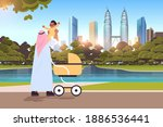 arab father holding little son... | Shutterstock .eps vector #1886536441