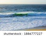 Sunlight Hits The Waves Near...