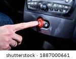 Male Hand Pressing A Hazard...