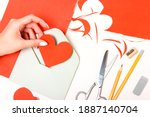 the girl holds in her hand a... | Shutterstock . vector #1887140704