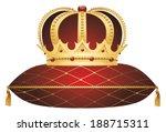 gold crown on red velvet...