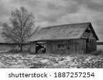 An Old Barn House Stands On The ...