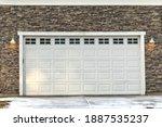 A White Garage Door With...