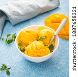 Small photo of Mango ice cream, sorbet in a plate on a concrete background, close up