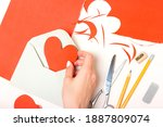 the girl holds in her hand a... | Shutterstock . vector #1887809074