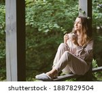 Woman In Terrace With Cup Of...