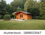 Orange Wooden Hut In The Garden ...