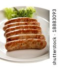 grilled sausage with lettuce isolated on white - stock photo