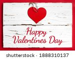 Red Heart On White Wooden And...