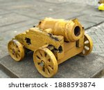 An Old Yellow Cannon On Display ...