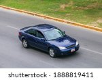 Cancun, Mexico - June 3, 2017: Dark blue saloon car Ford Mondeo in the city street. - stock photo