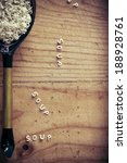 Small photo of Alphabet soup pasta on wooden table. Rustic