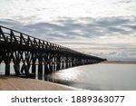 A Long Wooden Boardwalk Pier...