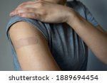 A Woman Showing Her Arm With An ...
