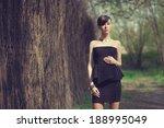 Brunette Model Posing In Short...