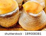 Close-up of sprinkled sugar cream pies