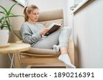 Blonde Woman Reading Book While ...