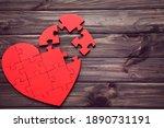 Broken Puzzle Heart On Brown...