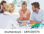 smiling design team going over... | Shutterstock . vector #189100574