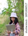the little asian girl holding...   Shutterstock . vector #1891008517