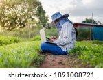 thai farmer using a smartphone...   Shutterstock . vector #1891008721