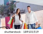 happy young couple with bags in ... | Shutterstock . vector #189101519