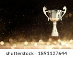 Image Of Silver Trophy Over...