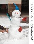 Snowman Motorist Stands In...