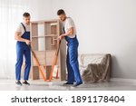Loaders Carrying Furniture In...
