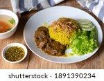 muslim yellow rice with beef... | Shutterstock . vector #1891390234