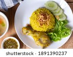muslim yellow rice with chicken ... | Shutterstock . vector #1891390237