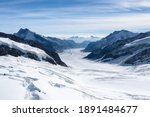 Amazing view of Aletsch Glacier, the largest glacier in the Alps, world heritage of Swiss and Bernese alps alpine snow mountains peaks, beautiful landscapes view downhill from the top of Jungfraujoch.