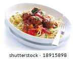 White bowl of spaghetti and meatballs in a bolognese sauce.  Isolated on white. - stock photo