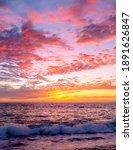 A Colorful Ocean Sunset Sky As...