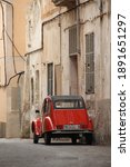 Small photo of Majorca,Spain-August 30,2015: Classis red Citroen parking on the road in village,is a French automobile manufacturer. It was founded in March 1919 by industrialist Andre-Gustave Citroen.