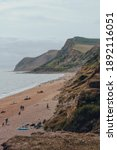 Small photo of Eype Beach, UK - July 25, 2020: Scenic view of Thorncombe Beacon hill and Eype Beach, a secluded and unspoiled beach on Dorset's Jurassic Coast.