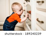 curious baby watching through... | Shutterstock . vector #189240239