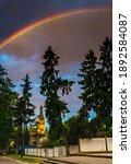 Rainbow Above Church And Park...