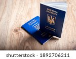 Ukrainian passport for traveling to other countries. Two biometric international passports of a citizen of Ukraine. Selective focus on english lettering.