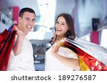 happy young couple with bags in ... | Shutterstock . vector #189276587