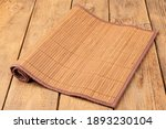 Bamboo Mat For Food On A Wooden ...