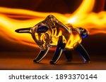 Bull Figurine On A Black...