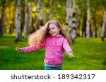 happy girl running in the park.... | Shutterstock . vector #189342317