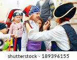 woman painting kid's face on... | Shutterstock . vector #189396155