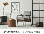 Small photo of Stylish scandinavian composition of living room with design armchair, black mock up poster frame, commode, wooden stool, book, decoration, loft wall and personal accessories in modern home decor.