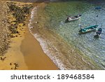 Boats In Water By The Beach Of...
