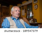 retired man at home watching tv. | Shutterstock . vector #189547379