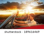 couple driving convertible car... | Shutterstock . vector #189616469