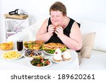 fat man has a big lunch  on...   Shutterstock . vector #189620261