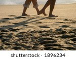 people walk on the beach barefooted - stock photo